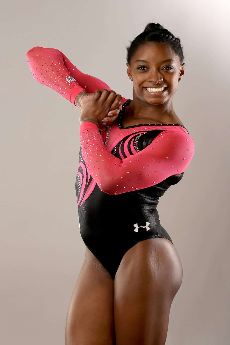 What is Simone Biles total assets?