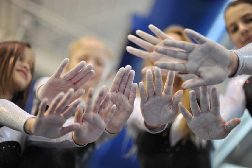 gymnasts show chalk on their hands 846x564 1